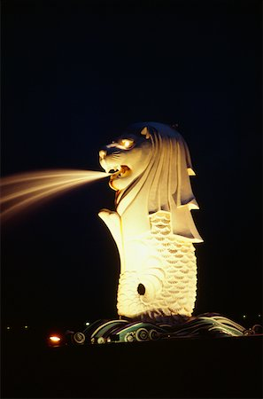Merlion fountain lit up at night, Merlion Park, Singapore Stock Photo - Premium Royalty-Free, Code: 625-01263675