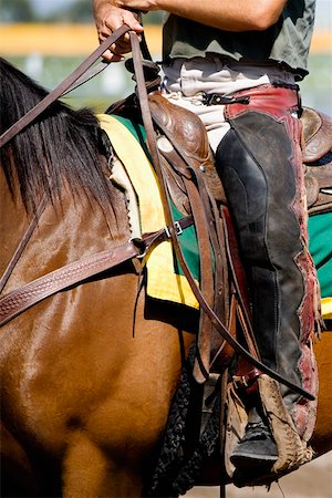 Low section view of a jockey riding a racehorse Stock Photo - Premium Royalty-Free, Code: 625-01744936