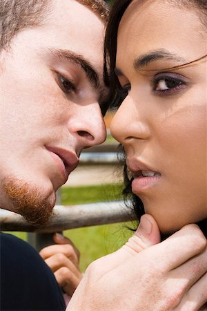 preteen kissing - Close-up of a young man about to kiss a teenage girl Stock Photo - Premium Royalty-Free, Code: 625-01746499