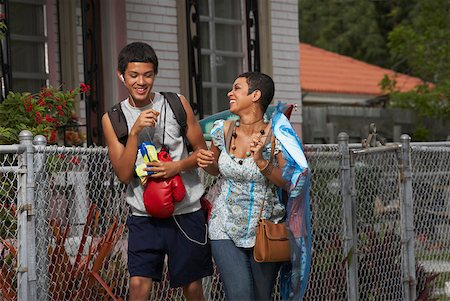 Teenage boy and his sister walking and smiling Stock Photo - Premium Royalty-Free, Code: 625-01746815