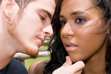 preteen kissing - Close-up of a young man about to kiss a teenage girl Stock Photo - Premium Royalty-Free, Code: 625-01746936