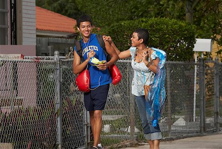 Teenage boy and his sister walking on the walkway Stock Photo - Premium Royalty-Free, Code: 625-01747805