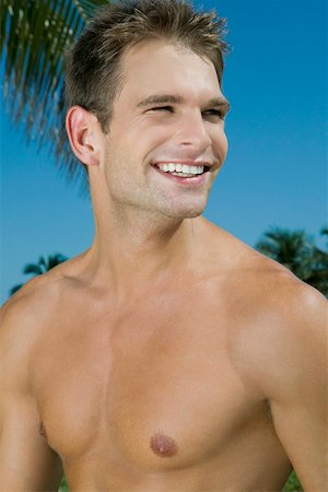 Close-up of a young man smiling Stock Photo - Premium Royalty-Free, Code: 625-01748144