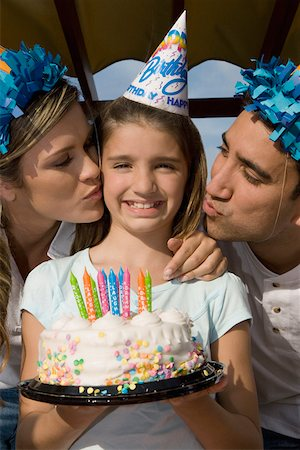 preteen kissing - Portrait of a girl holding a birthday cake and her parents kissing her Stock Photo - Premium Royalty-Free, Code: 625-01748253