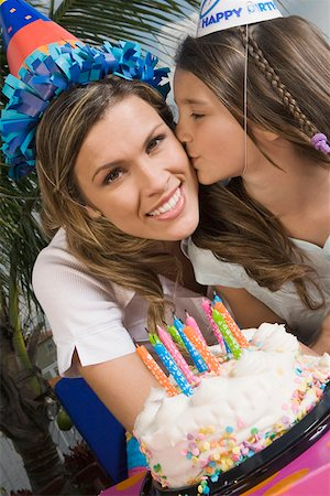 preteen kissing - Portrait of a girl kissing her sister in front of a birthday cake Stock Photo - Premium Royalty-Free, Code: 625-01748274