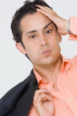 sweaty businessman - Portrait of a businessman suffering from a headache Stock Photo - Premium Royalty-Free, Code: 625-01748412