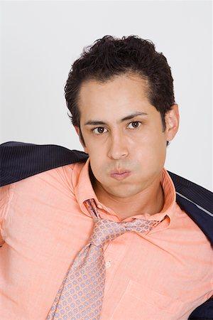sweaty businessman - Portrait of a businessman putting off his coat Stock Photo - Premium Royalty-Free, Code: 625-01748431