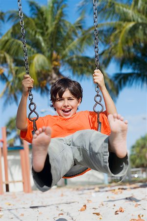 Boy swinging on a swing Stock Photo - Premium Royalty-Free, Code: 625-01748745