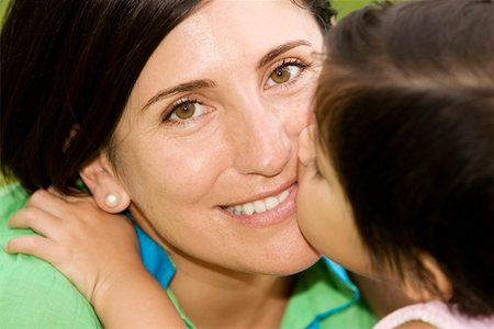 daughter kissing mother - Close-up of a girl kissing her mother Stock Photo - Premium Royalty-Free, Code: 625-01748768