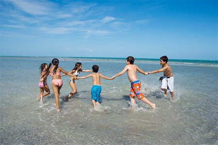 Children playing with holding each other hands on the beach Stock Photo - Premium Royalty-Free, Code: 625-01748907