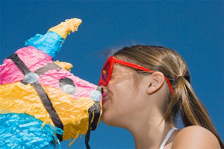 preteen kissing - Low angle view of a girl kissing a rocking horse Stock Photo - Premium Royalty-Free, Code: 625-01749014