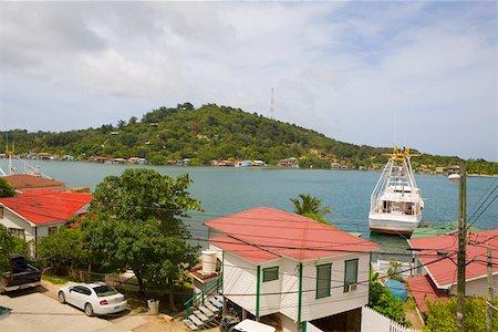 High angle view of a house on the coast, Jonesville, Roatan, Bay Islands, Honduras Stock Photo - Premium Royalty-Free, Code: 625-01751951