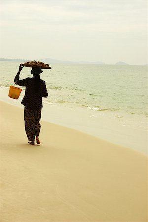 Rear view of a woman walking on the beach, Sihanoukville, Cambodia Stock Photo - Premium Royalty-Free, Code: 625-01752676