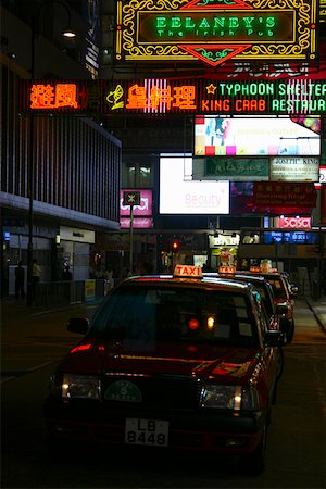 Taxi parked in a row in a market, Kowloon, Hong Kong, China Stock Photo - Premium Royalty-Free, Code: 625-01752834