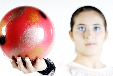 Portrait of a female gymnast holding a ball Stock Photo - Premium Royalty-Free, Code: 625-02266306