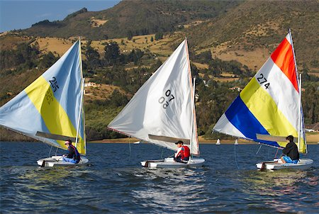 sports and sailing - Three people participating in a sailboat race Stock Photo - Premium Royalty-Free, Code: 625-02266415