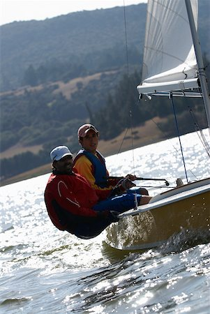 sports and sailing - Two men participating in a sailboat race Stock Photo - Premium Royalty-Free, Code: 625-02266423