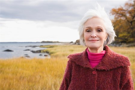 Close-up of a senior woman smiling Stock Photo - Premium Royalty-Free, Code: 625-02266472