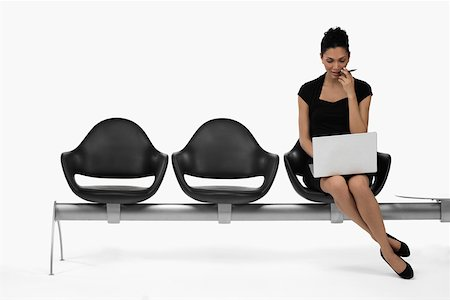 female white background full body - Businesswoman sitting on a bench and using a laptop Stock Photo - Premium Royalty-Free, Code: 625-02266547