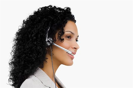 Close-up of a female customer service representative wearing a headset Stock Photo - Premium Royalty-Free, Code: 625-02266894