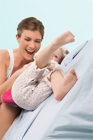 Close-up of a mid adult woman playing with her daughter Stock Photo - Premium Royalty-Free, Code: 625-02267375