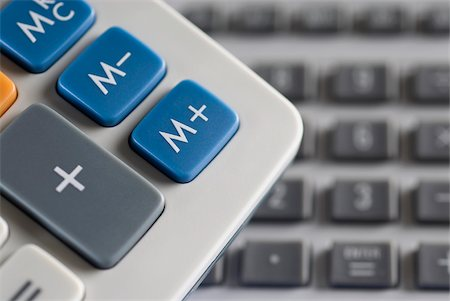 Mathematical symbols on a calculator and a computer keyboard in the background Stock Photo - Premium Royalty-Free, Code: 625-02926804