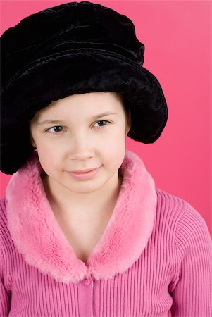 preteen  smile  one  alone - Close-up of a girl wearing a fur hat Stock Photo - Premium Royalty-Free, Code: 625-02927265