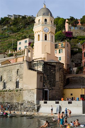 sand clock - Low angle view of a church in a town, Church of Santa Margherita d'Antiochia, Italian Riviera, Cinque Terre National Park, Vernazza, La Spezia, Liguria, Italy Stock Photo - Premium Royalty-Free, Code: 625-02927750