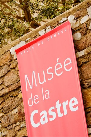 Close-up of a banner hanging on a stone wall, Musee De La Castre, Cote d'Azur, Cannes, Provence-Alpes-Cote D'Azur, France Stock Photo - Premium Royalty-Free, Code: 625-02928443