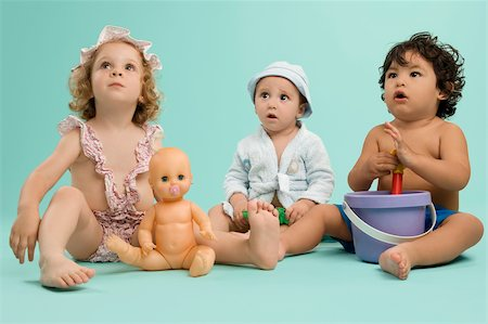Three children playing with toys Stock Photo - Premium Royalty-Free, Code: 625-02929316
