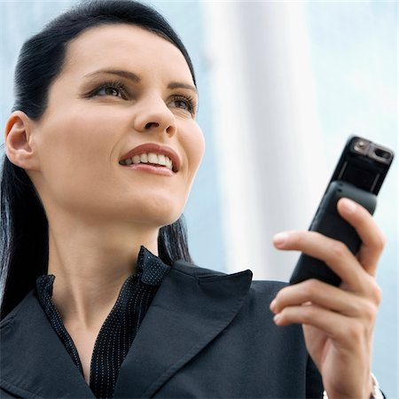 Close-up of a businesswoman using a mobile phone Stock Photo - Premium Royalty-Free, Code: 625-02929459