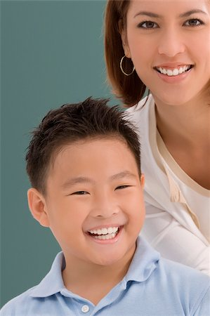 Portrait of a schoolboy with his female teacher smiling together in a classroom Stock Photo - Premium Royalty-Free, Code: 625-02930462