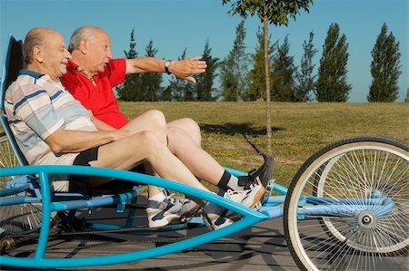 Side profile of two senior men on a quadracycle Stock Photo - Premium Royalty-Free, Code: 625-02931032