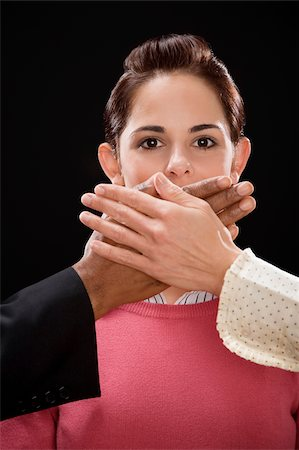 restrained - Close-up of a person's hand covering a businesswoman's mouth Stock Photo - Premium Royalty-Free, Code: 625-02931286