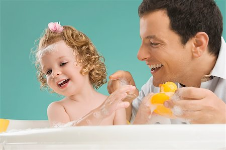 Mid adult man playing with his daughter Stock Photo - Premium Royalty-Free, Code: 625-02932467
