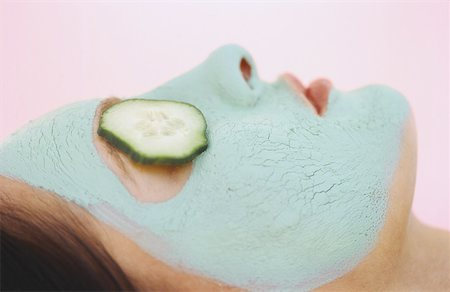 woman with a face pack and cucumber slices Stock Photo - Premium Royalty-Free, Code: 627-00854778