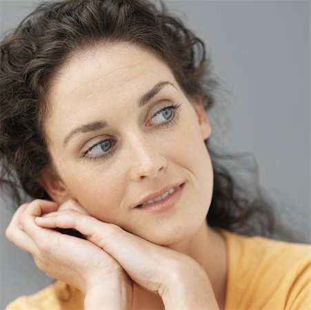 Close-up of young woman daydreaming Stock Photo - Premium Royalty-Free, Code: 627-00855271