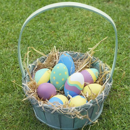 Elevated view of a basket filled with Easter eggs Stock Photo - Premium Royalty-Free, Code: 627-00857186