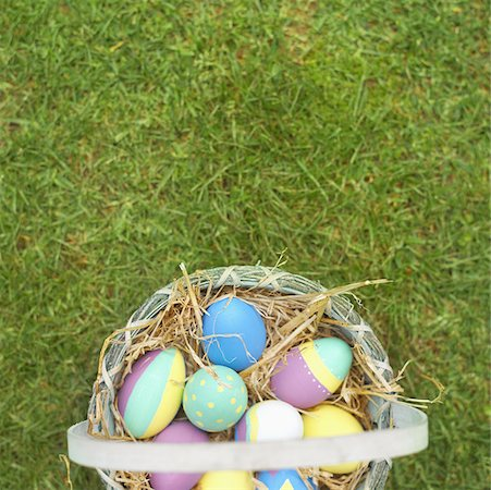 Elevated view of a basket filled with Easter eggs Stock Photo - Premium Royalty-Free, Code: 627-00857189