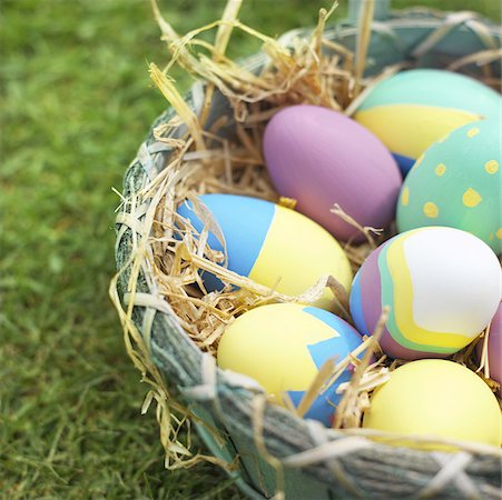 Elevated view of a basket filled with Easter eggs Stock Photo - Premium Royalty-Free, Code: 627-00857190