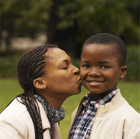 preteen kissing - Close-up of mother kissing son (10-11) Stock Photo - Premium Royalty-Free, Code: 627-00857821