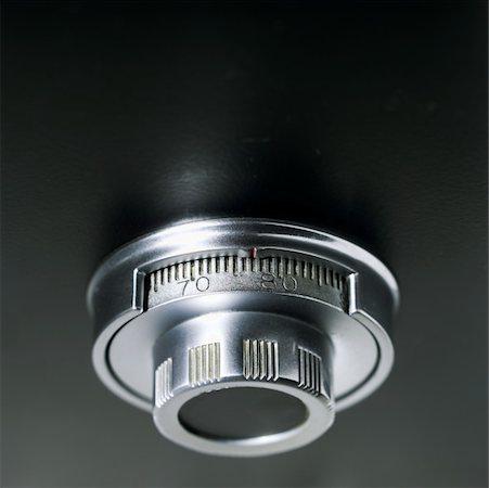 Close-up of combination lock Stock Photo - Premium Royalty-Free, Code: 627-00858549