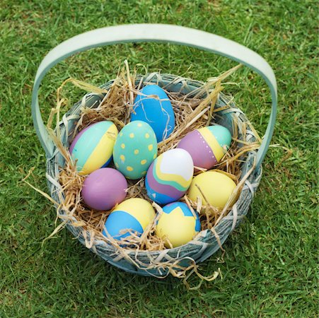 Elevated view of a basket filled with Easter eggs Stock Photo - Premium Royalty-Free, Code: 627-00862281
