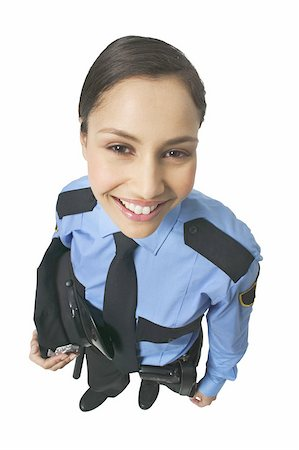 female police officer happy - Portrait of a policewoman Stock Photo - Premium Royalty-Free, Code: 627-01065548