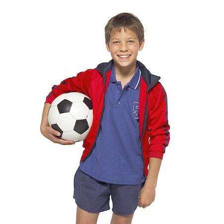 preteen  smile  one  alone - front view portrait of a boy (11- 12) holding a soccer-ball Stock Photo - Premium Royalty-Free, Code: 627-01067349
