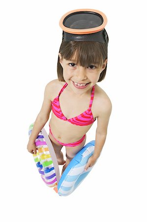 Elevated view of a girl (8-9) holding float Stock Photo - Premium Royalty-Free, Code: 627-01067391