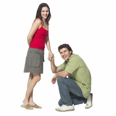 Mid adult man kneeling on one knee and proposing to mid adult woman Stock Photo - Premium Royalty-Free, Code: 627-01068779