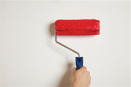 White wall is being painted in red, Germany Stock Photo - Premium Royalty-Free, Code: 628-05817337