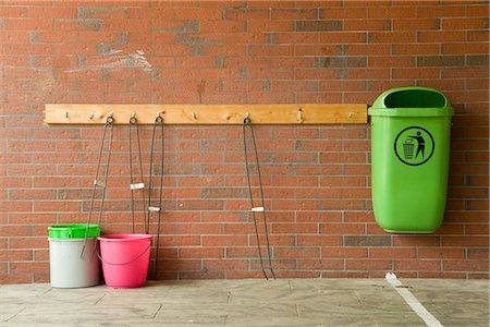 Green trash can and buckets at brick wall, Hamburg, Germany Stock Photo - Premium Royalty-Free, Code: 628-05817351