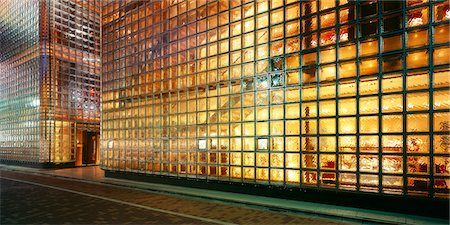House made of glass bricks, illuminated Stock Photo - Premium Royalty-Free, Code: 628-05817402